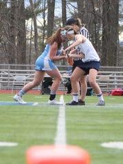 Burlington's Casey O'Neill faces off against a South