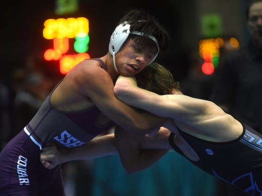 Spanish Springs' Jacob Ruiz, left, takes on Terrell Barraclough of Utah during their 126-pound semifinal match during the Reno Tournament of Champions wrestling event at the Reno Events Center on Dec. 16.