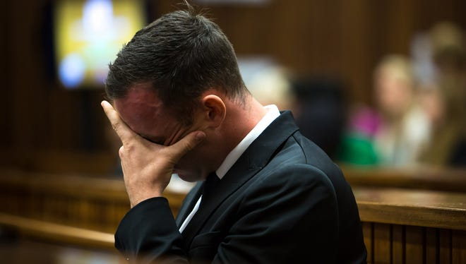 Oscar Pistorius sits in the dock on 11th day of his trial for the murder of his girlfriend Reeva Steenkamp.