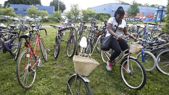Theresa Bowick, captain of the Conkey Cruisers, admires one of the older bikes that was donated by the Democrat and Chronicle.