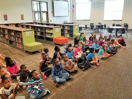 Edmunds first-grade students learn about library expectations over the first days of the 2017-18 school year.