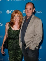 """FILE - This Sept. 18, 2012 file photo shows Lori Weintraub, left, and actor Miguel Ferrer at the CBS 2012 Fall Premiere Party in West Hollywood, Calif. Ferrer, who brought stern authority to his featured role on CBS' hit drama """"NCIS: Los Angeles"""" and, before that, to """"Crossing Jordan,"""" died, Thursday, Jan. 19, 2017, of cancer at his Los Angeles home. He was 61. (Photo by Todd Williamson/Invision/AP, File)"""