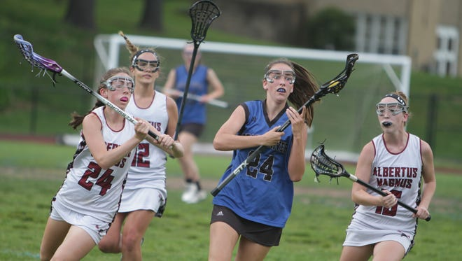 Action during a Section 1 girls lacrosse tournament Class C semifinal game between Albertus Magnus and Pearl River at Albertus Magnus High School on Monday, May 23rd, 2016. Pearl River won 6-5.