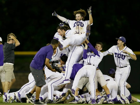 TCU 's Garrett Crain, center, celebrates with teammates following the 16th inning of a Super Regional-clinching win over Texas A&M on Monday in Fort Worth, Texas.