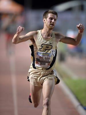 FILE --  Matt McClintock of Purdue celebrates after winning the invitational 10,000m in 28:54.77 the 57th Mt. San Antonio College Relays at Hilmer Lodge Stadium.