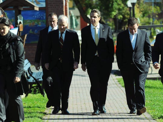 Gov. Andrew Cuomo, center, walks along the Rondout Creek in Kingston with co-chairs of the Mid-Hudson Regional Economic Development Council on Thursday, Oct. 11, 2012. Mid-Hudson Regional Co-Chairs are Dennis Murray, left, Marist College president and Leonard S. Schleifer, MD, President & CEO, Regeneron Pharmaceuticals.
