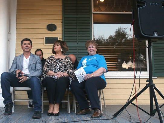 Actor Lou Diamond Phillips sits next to City Councilwoman