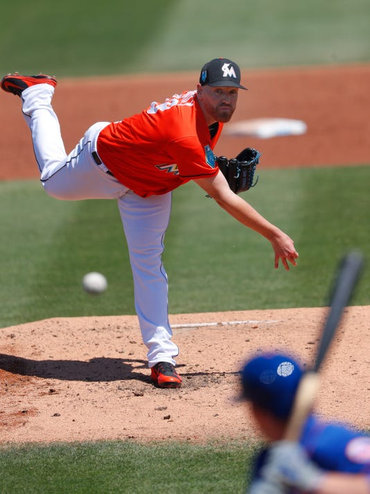 Miami Marlins starting pitcher Dan Straily (58) delivers to a New York Mets batter in the second inning of a spring training baseball game Wednesday, March 14, 2018, in Jupiter, Fla. (AP Photo/John Bazemore)