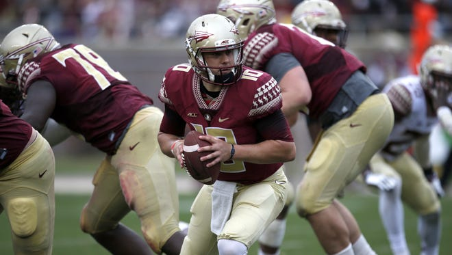 Sean Maguire looks back during a play action call in the Garnet and Gold spring game at Doak Campbell Stadium on Saturday.
