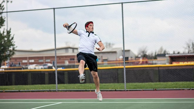 Rossview's Tristen Hester returns a shot against a district opponent during a match earlier this spring. Hester was one of five Rossview players selected to the All Area Boys' Tennis Team.