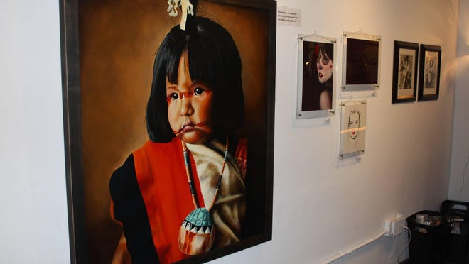 """""""Hopi Girl,"""" by an artist who goes by the name """"Tooter,"""" was part of the first """"Art With Conviction"""" show in October 2014 at Haunted Hands Gallery in Tucson."""