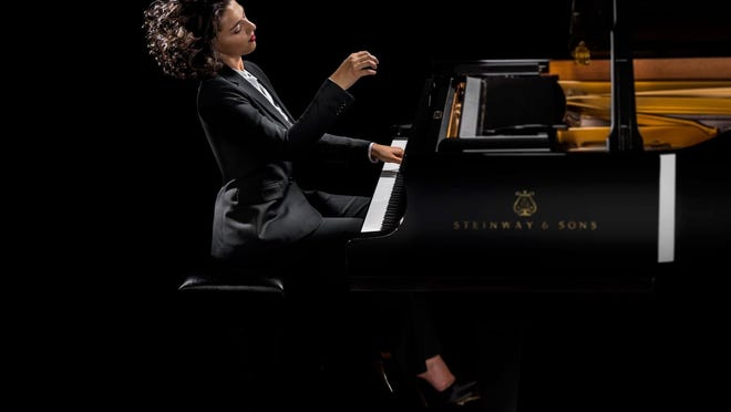 Pianist Khatia Buniatishvili performed a piece by Franz Liszt with the Royal Philharmonic Orchestra on Sunday at the Kravis Center.
