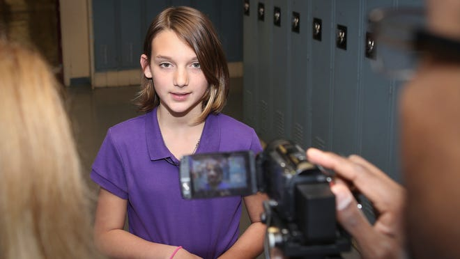 Sixth-grade Wassom Middle School student Holly Widen was recognized for saving her father's life.