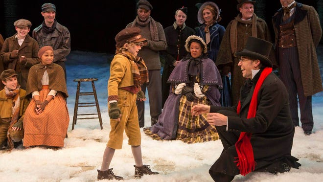 """Henry Cooper (center), a young actor from Muncie, portrays Tiny Tim in the Indiana Repertory Theatre's production of """"A Christmas Carol."""""""