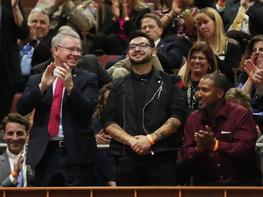 Juan Carlos Montes De Oca, center, is mentioned by Gov. Doug Ducey during his State of the State speech at the Capitol in Phoenix on Jan. 8, 2018. The Tucson man was threatened by the State Board of Cosmetology last year because he was giving free haircuts to homeless people.