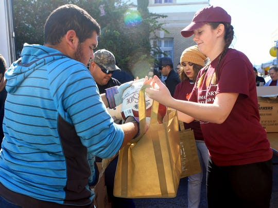 Volunteers prepare bags filled with a turkey during the Thomas J. Henry Turkey Giveaway on Saturday, Nov. 19, 2016, in Corpus Christi.