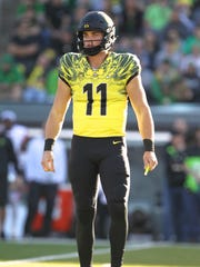 Oregon quarterback Braxton Burmeister (11) watches for the play to come in from the sideline Saturday.