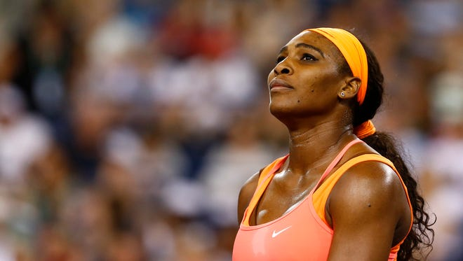 Serena Williams looks on against Monica Niculescu at the BNP Paribas Open on March 13, 2015 in Indian Wells.