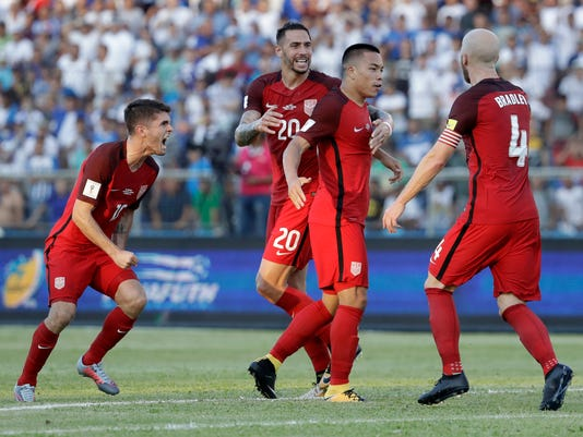 United States' Bobby Wood, second right, celebrates with teammates after scoring his team's first goal during a 2018 World Cup qualifying soccer match against Honduras in San Pedro Sula, Honduras, Tuesday, Sept. 5, 2017. The match ended in a 1-1 tie. (AP Photo/Rebecca Blackwell)