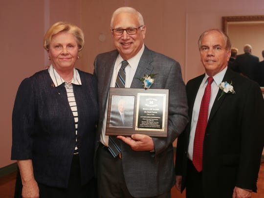 Metuchen High School's Inaugural Hall of Fame Induction ceremony at The Gran Centurions in Clark on May 22, 2016. From left, Ms. Dianne Hunter Kuenzel, honoree Dr. Scott Cowen, Class of 1964, and Bruce Peragallo, Metuchen High School principal.
