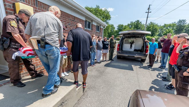 Sabo is carried out of a Chesterfield animal hospital, where he had been euthanized, on Wednesday, July 19, 2017.