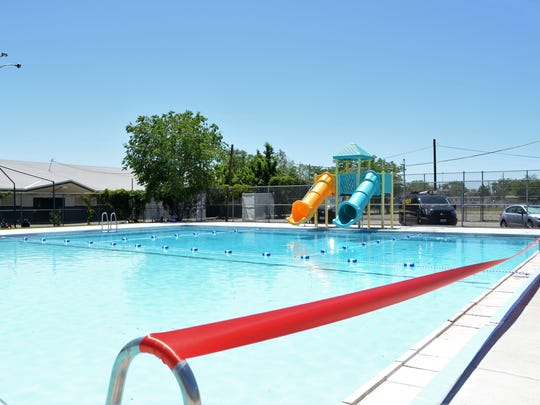A red ribbon stretched across the edge of Traner Pool on Monday, June 11, during the community pool's grand reopening.