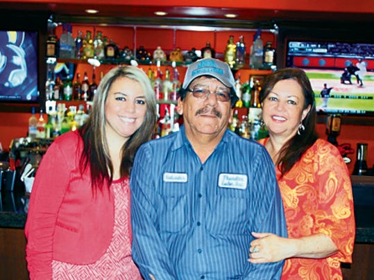 Courtesy Photo   The Gutierrez family, from left, daughter Sylvana and parents, Sal and Gloria, are the proud owners of Yoya's Bar & Grill at 1624 S. Columbus Road, next to Yoya's Market. The Gutierrez family hopes to bring a fine dining experience — with elegance — to the public.