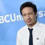 """FILE - In this April 2, 2015 file photo, David Duchovny arrives at the NBC Universal Summer Press Day at in Pasadena, Calif. NBC announced Thursday, April 30, that all 13 episodes of """"Aquarius,"""" starring Duchovny, will be available online after the drama's two-hour NBC premiere. It will remain on digital platforms for four weeks after its May 28 broadcast debut. (Photo by Chris Pizzello/Invision/AP, File)"""