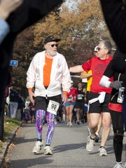 Rochester's Don McNelly, left, receives encouragement from an unidentified runner during the 2010 Harrisburg Marathon in Harrisburg, Pa. Mr. McNelly completed 744 marathons, including 177 past age 80. He died Feb. 5 at 96.