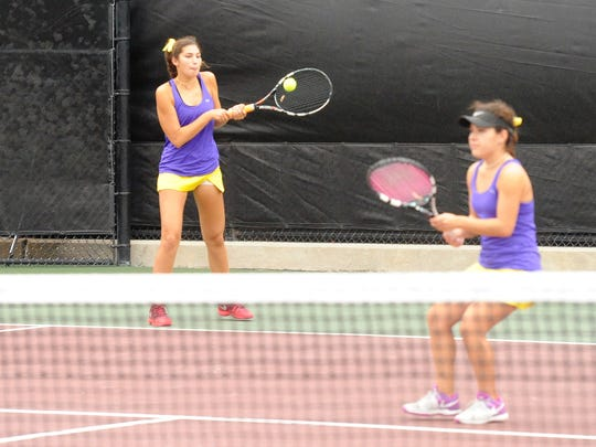 Wylie's Kaithlyn Hathorn, left, returns a serve while No. 1 girls doubles partner Analeah Elias waits against Fredericksburg in the Class 4A state finals on Thursday, Nov. 2, 2017 at the George P. Mitchell Tennis Center in College Station. Hathorn and Elias won 6-3, 6-4.