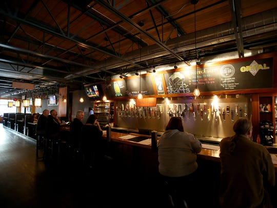 The interior of 7 Monks brewery and restaurant that is managed by general manager Jason Kasdorf in Traverse City, Michigan on May 26, 2017.