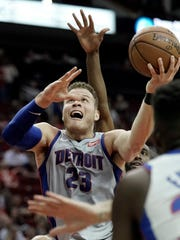 The Pistons' Blake Griffin (23) goes up for a shot