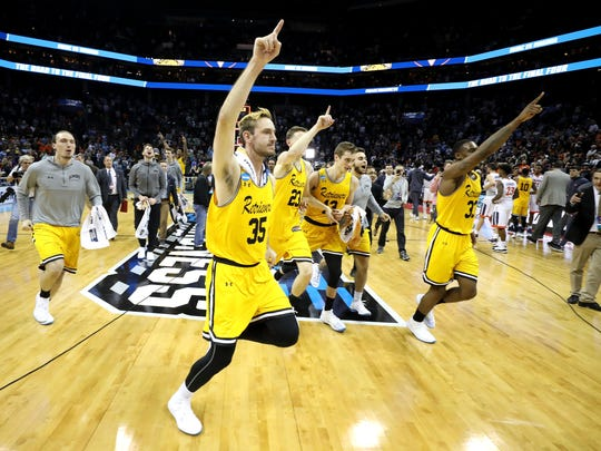 The UMBC Retrievers celebrate their 74-54 victory over