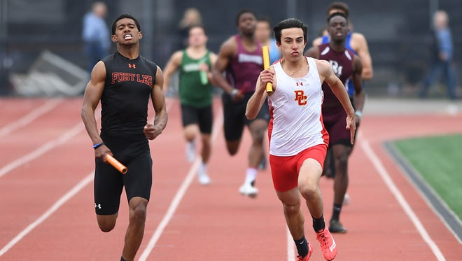 Bergen County Relays at River Dell High School on Friday, April 21, 2017. (left) Michael Huertas, of Fort Lee, and Ryan Zihenni, of Bergen Catholic, compete in the 800 meter relay.