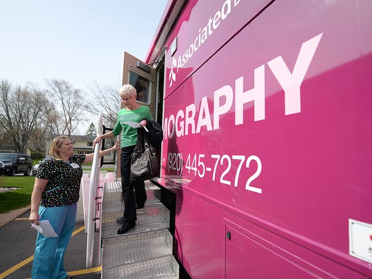 The new Bellin Health mobile mammography imaging center visited Algoma Thursday. Client Marietta Kenzik heads out the door of the vehicle with technician Heather Hassemer.