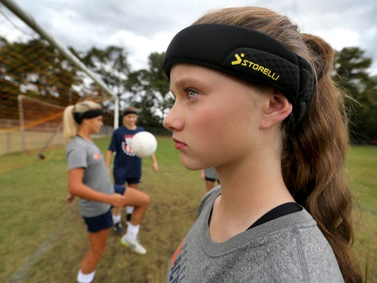 Blackman's Katelyn Davis, a freshman models the headband that all Blackman girls soccer players must wear before getting on the field for either a game or practice, on Monday, Sept. 28, 2015, before a game against Smyrna. The headbands are suppose to lessen the chances of receiving a concussion.