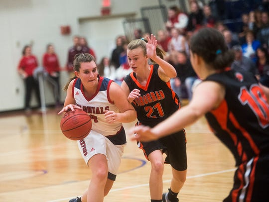 New Oxford's Breanne Sauter drives to the basket as