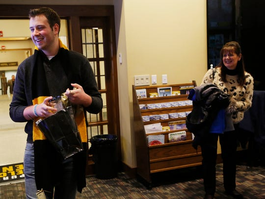 Stephen Quillin laughs as he opens gifts moments after Kris Wong Davis, Vice Provost for Enrollment Management, surprised him with the first admissions offer for the class of 2022 Wednesday, January 3, 2018, in the Purdue Memorial Union. Quillin, 18, from Sheridan, has a heart condition called hypertrophic cardiomyaopathy.