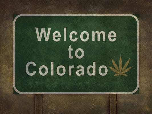 Welcome to Colorado (with marijuana leaf symbol) roadside sign