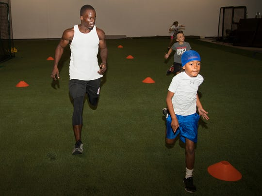 Noel Devine, left, trains Patrick Ryan Jr., 6, right, on Wednesday at Cape Coral Indoor Athletics. The facility opened this month and features multi-sport performance training, summer camps, batting cages and speed and conditioning classes.