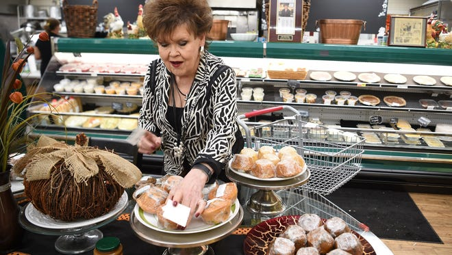 Daisy King stocks and prices muffins at her business, Miss Daisy's Kitchen, which was previously located in the former Grassland Foodland.