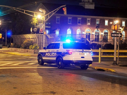 A police car at the scene where three police officers were struck by a motorcycle while investigating a previous fatal accident on Palisade Avenue at 30th Street in Union City around 9 p.m. on Oct. 4, 2017.