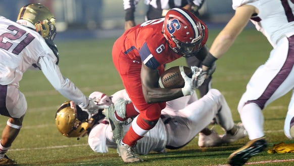 Stepinac's Atrilleon Williams (6) looks for some running