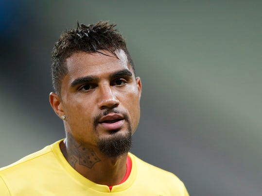 Ghana's Kevin-Prince Boateng warms up during an official training session the day before the group G World Cup soccer match between Germany and Ghana at the Arena Castelao in Fortaleza, Brazil, Friday, June 20, 2014. (AP Photo/Matthias Schrader)