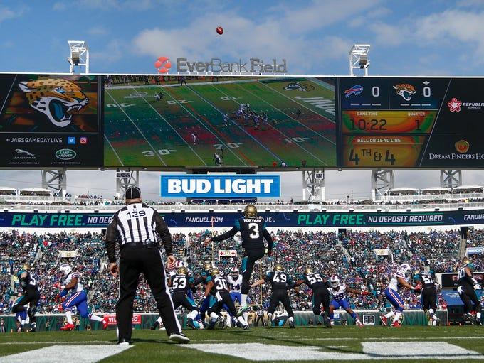 Jacksonville Jaguars punter Brad Nortman (3) punts