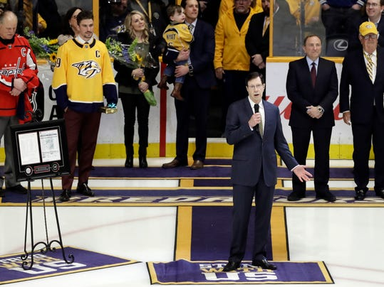 Nashville Predators general manager David Poole speaks during a ceremony honoring him before an NHL hockey game between the Predators and the Anaheim Ducks Thursday, March 8, 2018, in Nashville, Tenn. Poile was recognized for becoming the winningest general manager in NHL history, a feat he accomplished on March 1 in Edmonton with his 1,320th career victory. (AP Photo/Mark Humphrey)