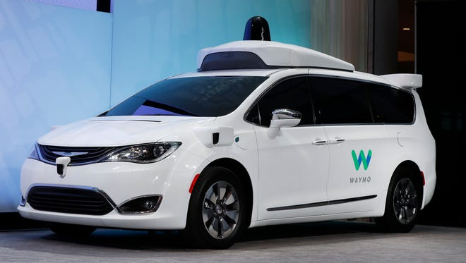 A Chrysler Pacifica hybrid outfitted with Waymo's suite of sensors and radar is displayed at the North American International Auto Show in Detroit in January 2017.