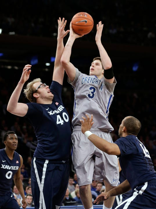 Creighton's Doug McDermott (3) shoots over Xavier's Matt Stainbrook (40) during the first half of an NCAA college basketball game in the semifinals of the Big East Conference men's tournament Friday, March 14, 2014, at Madison Square Garden in New York. (AP Photo/Frank Franklin II)