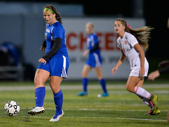 Sartell's Brooke Walters (20) moves the ball up field pursued by St. Cloud Tech's Emilie Miller (9) in the first half Tuesday evening, Sept. 27, at Husky Stadium.
