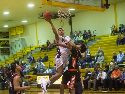 Delone's Tavian Dorsey reaches for the basket during